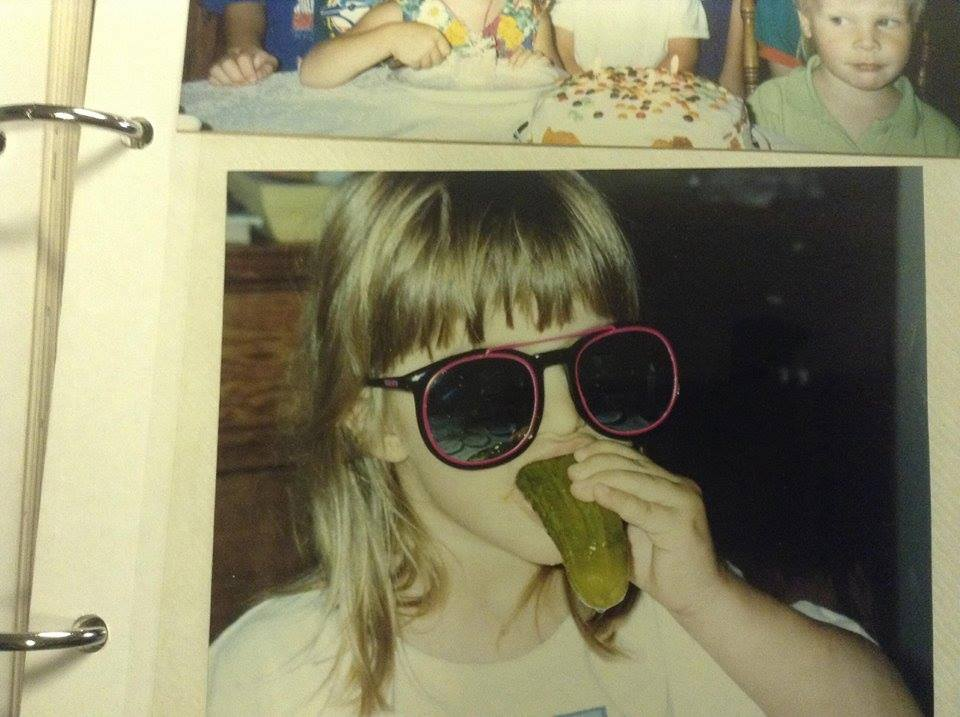 Young Alexis eating pickles