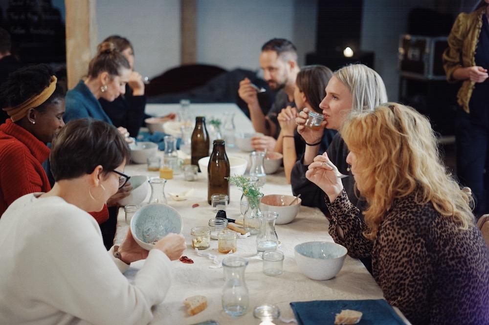 people sitting around table at 52 seasons dinner