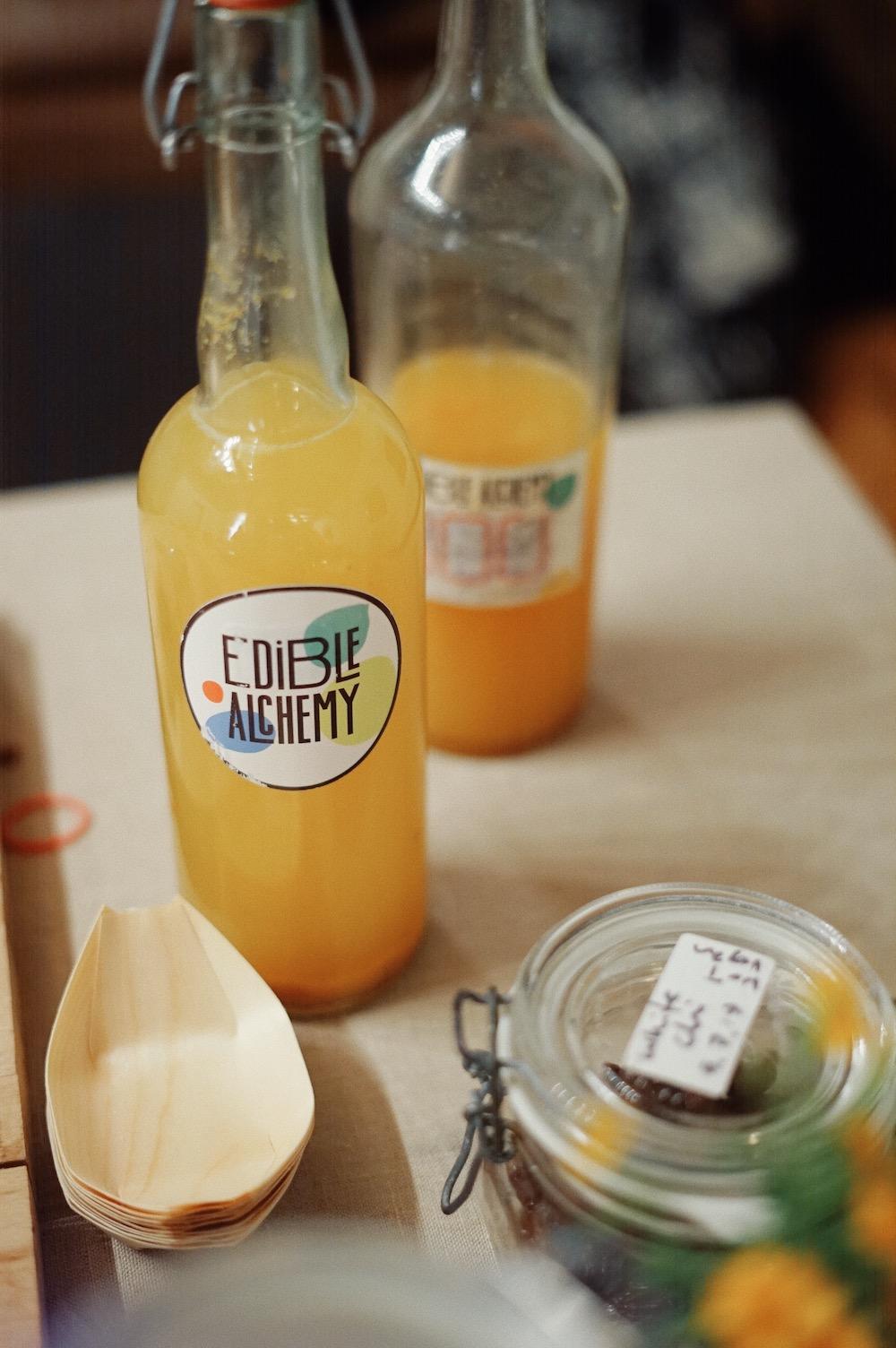 orange water kefir on table