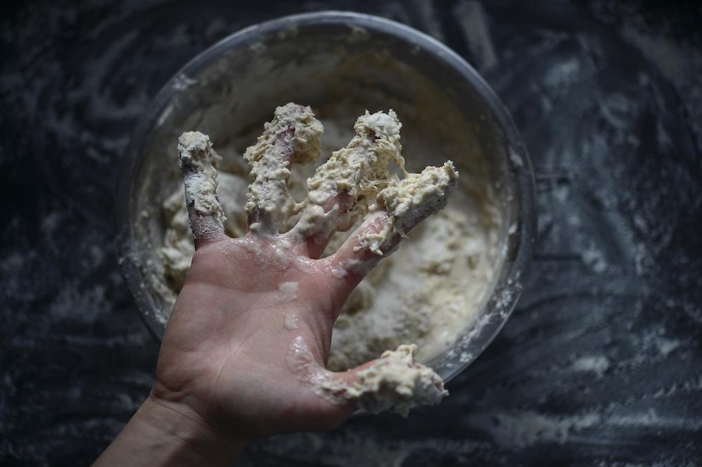 sourdough on hands